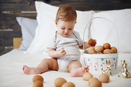 Baby with easter basket of eggs 스톡 콘텐츠 - 118974854