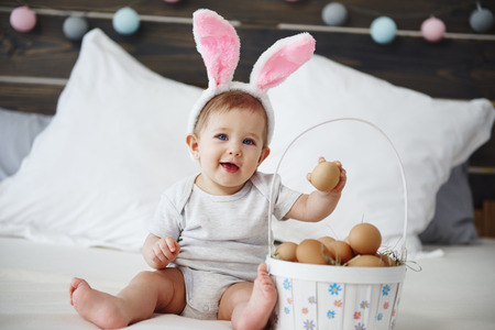 Portrait of adorable baby girl with easter basket