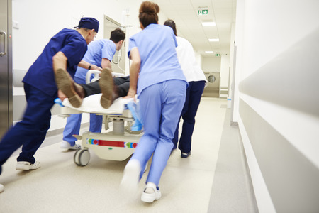 Rear view of doctors running for the surgery 스톡 콘텐츠