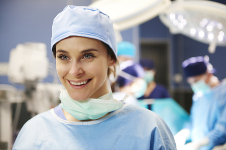 Portrait of female surgeon in operating room
