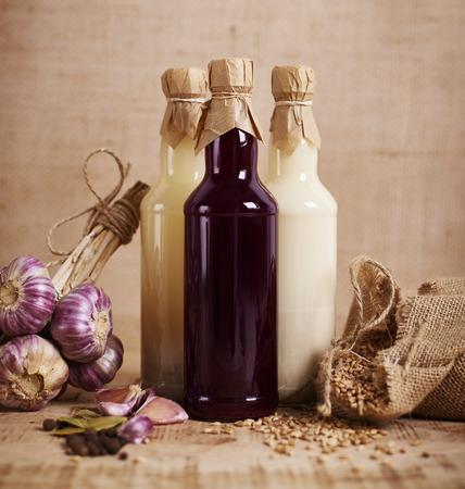 Three glass bottle of sourdough for Easter sour soup Banco de Imagens - 119580323