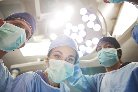 Low angle view of surgeons over the operating table