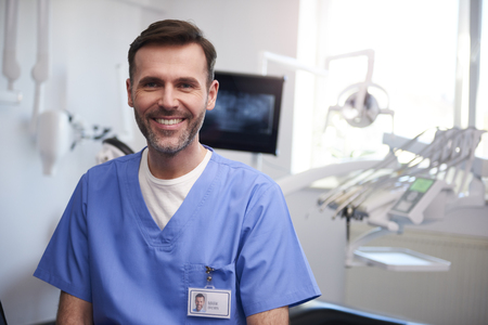 Portrait of smiling dentist in dentists office