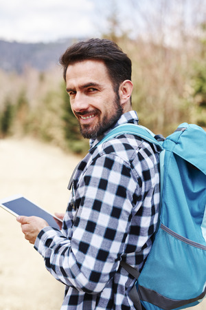 Portrait of smiling male hiker with backpack