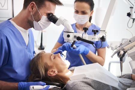 Male dentist working with dental microscope Stock fotó - 120790253