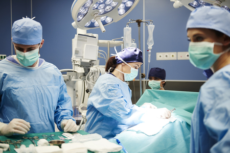 Operating room and team of surgeons Stock Photo