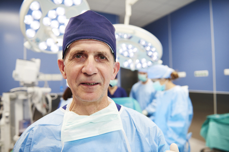 Portrait of smiling surgeon in the operating room