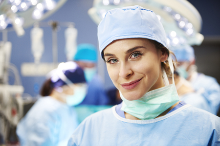 Portrait of smiling surgeon in operating room