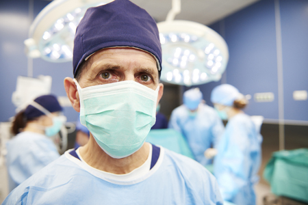 Portrait of senior surgeon in operating room