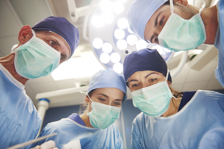 Team of surgeons over the operating table Stock Photo