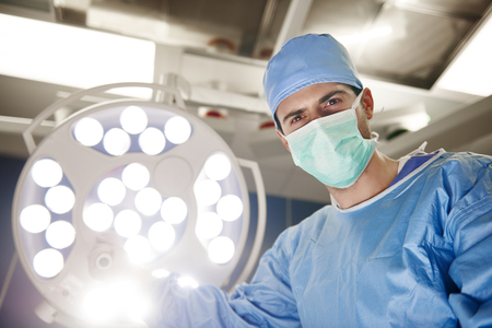 Portrait of confident surgeon in operating room