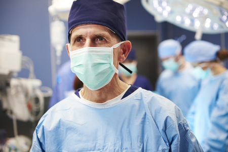 Portrait of senior surgeon ready for an operation Stock Photo