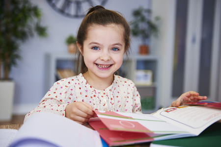 Portrait of smiling child studying at home Stock Photo