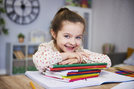 Smiling girl studying at home Stock Photo