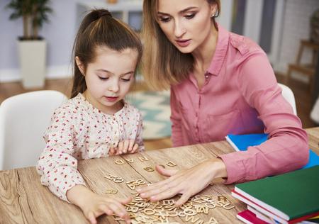 Focused child learning the alphabet 版權商用圖片