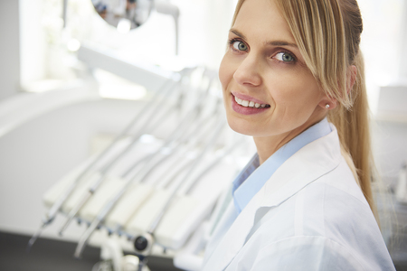 Portrait of smiling female dentist in dentists office Stok Fotoğraf