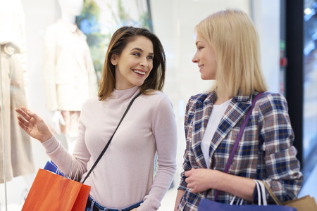 Good mood of two girls during big shopping