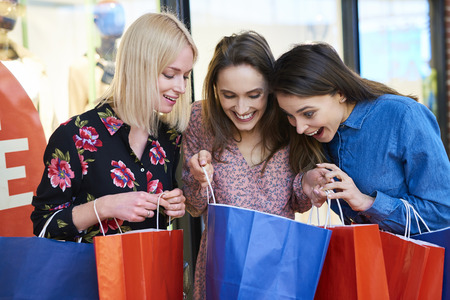 Young woman showing what she bought