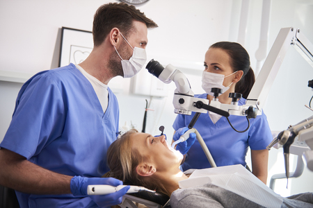 Conversation between two dentist in dentists clinic