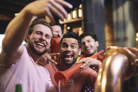 Great selfie of cheerful group of friends Stock Photo