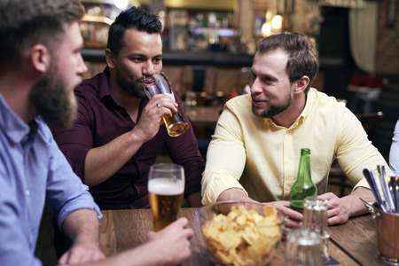 Three men spending time together in the pub