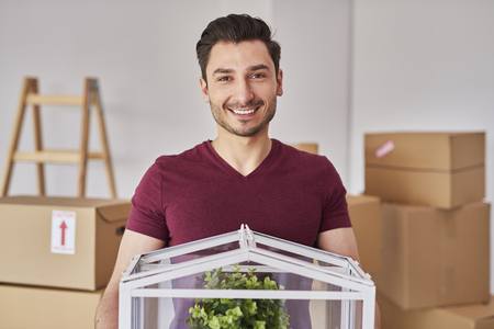 Portrait of smiling man moving into his new flat