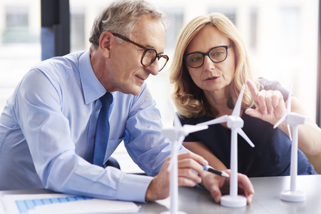 Business couple having consultations about wind energy Stock Photo