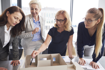 Four businesswomen working in the office
