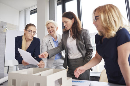 Team of businesswomen having consultations about strategy Stock Photo