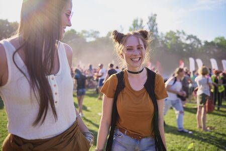 Woman laughing and enjoying music festival