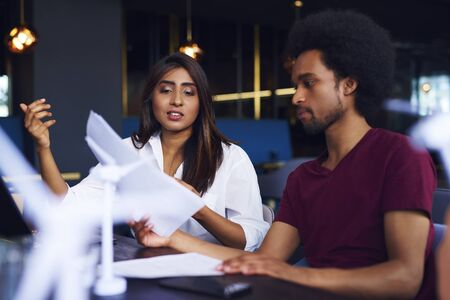 Business couple analyzing the documents at work Stock Photo