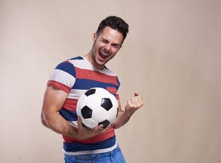 Excited football fan supporting his team Stockfoto