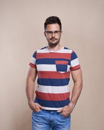 Portrait of handsome man in glasses in studio shot