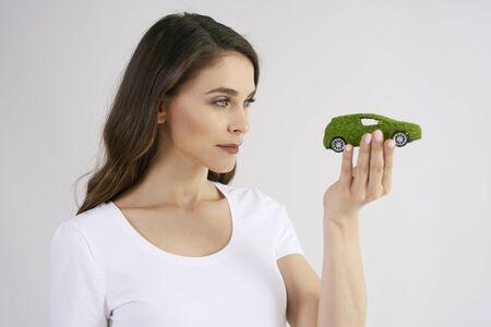 Woman looking at eco friendly car