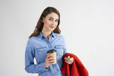 Portrait of young woman with disposable cup of coffee 版權商用圖片