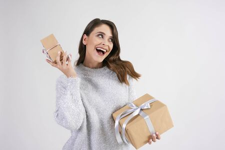 Happy woman holding two gifts in studio shot Stok Fotoğraf