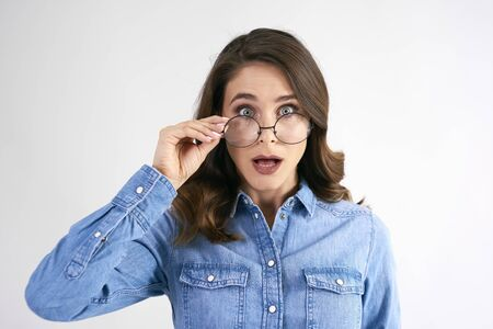 Portrait of surprised woman with glasses in studio shot Banco de Imagens - 127107241