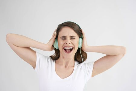 Joyful woman with headphones listening to music