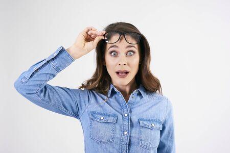 Shocked, young woman in studio shot