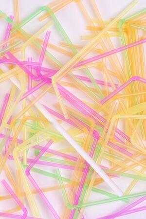 Bamboos straw among plastic drinking straws