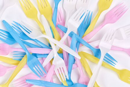 Colored, plastic forks on white background