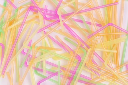 Group of colored drinking straws on white background