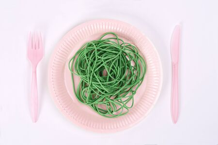 Plastic plate with green rubber bands