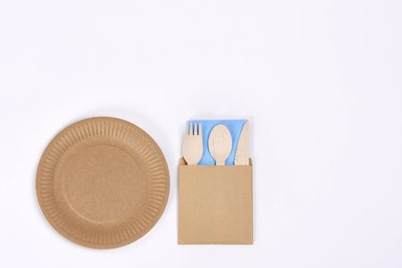 Eco silverware and empty plate on white background