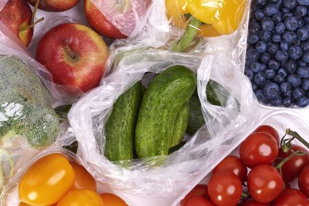 Plastic bags of fruits and vegetables Stock Photo