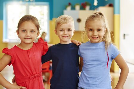 Portrait of three smiling children in the preschool