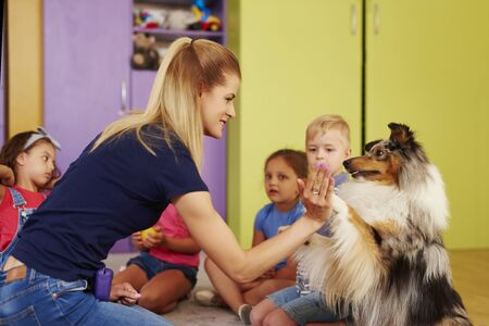 Therapy dog giving woman the paw Stock fotó
