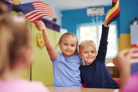 Portrait of two children learning languages in the classroom Stock Photo