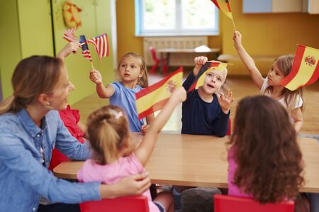 Group of  children learning languages during lessons in the school Stock Photo