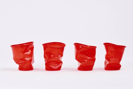 Four disposable plastic cups on white background